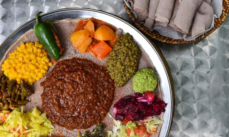 Spice filled curries, vegetables, lots of meat, and Injera, make up Ethiopian's local cuisine.